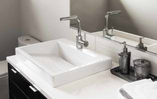Bathroom detail in new luxury home: sink and faucet with view of